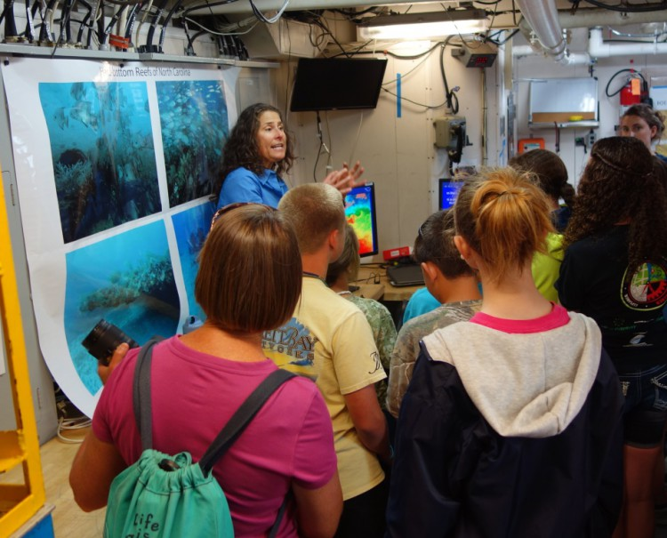 NOAA researcher Paula Whitfield uses underwater video and still frames to demonstrate to local middle school students the different types of hardbottom reefs in North Carolina's offshore waters. Credit: William Hoffman.