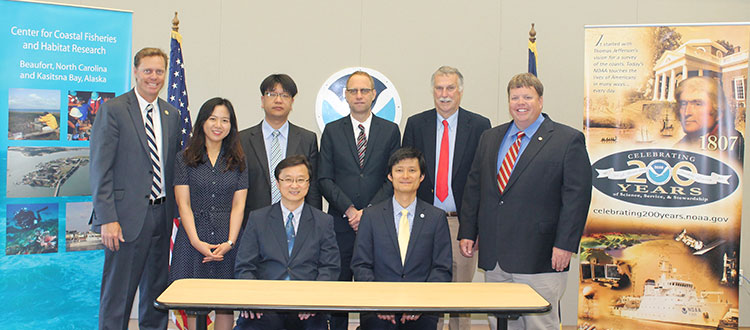 Signing ceremony for the Seventh Meeting of the Korea -U.S. Joint Coordination Panel for Aquaculture Cooperation.