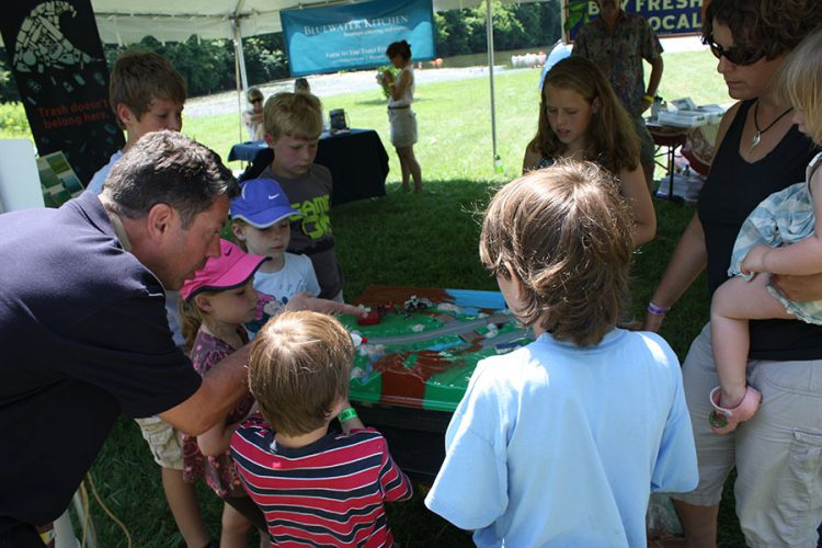 NOAA staff lead a children's activity as part of their River Awareness Workshop at the 2014 River and Roots Festival
