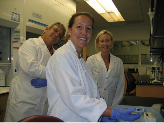 U.S. FDA Scientists Dr. Timothy Hawryluk and Marisa Reeves perform a receptor binding assay for paralytic shellfish poisoning toxins under the supervision of Analytical Response Team coordinator Dr. Maggie Broadwater (right). (Credit: T. Leighfield, NOAA)