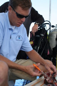 Dr. James Morris assessing lionfish stomach contents off North Carolina. Credit NOAA.