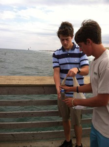 First Flight High School 'Phytofinders' sampling plankton from the red tide. Credit: First Flight High School.