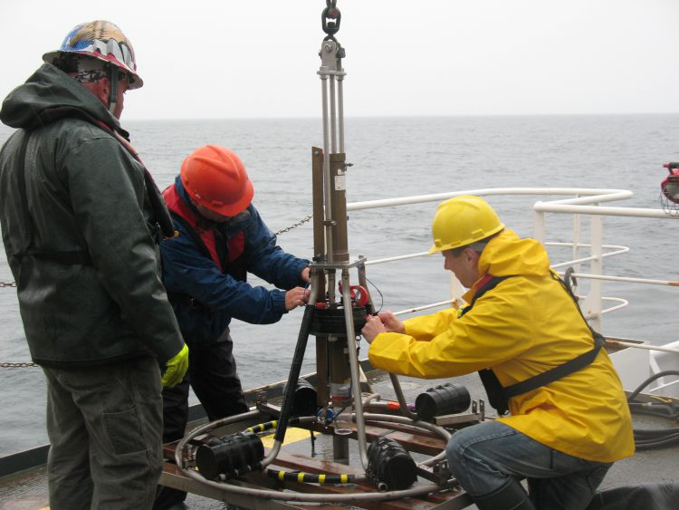 Preparing a Craib Corer for deployment in the Gulf of Maine. (Credit NOAA National Centers for Coastal Ocean Science)