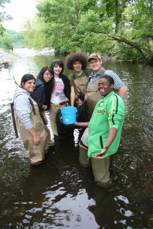 High school students collecting eels during educational programs in the Hudson River Reserve, one of the National Estuarine Research Reserves across the nation.