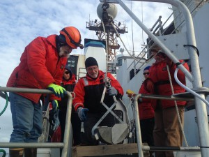 NOAA scientists prepare a corer to collect sediment samples. Credit: NOAA