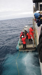 NOAA scientists descend from the Ron Brown onto the small boat to conduct further sampling. Credit: NOAA.