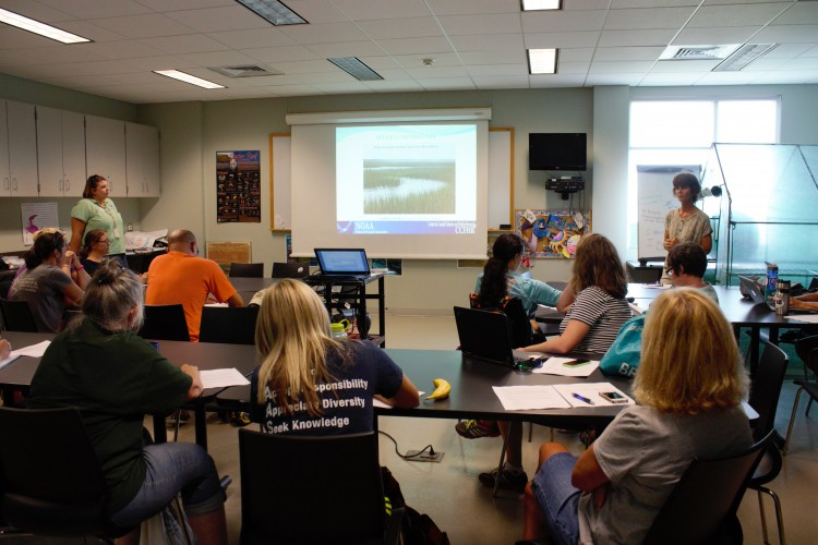 NCCOS scientist, Carolyn Currin, leads a Seeds to Shoreline seminar in the NERRs classroom to include students and teachers in marsh restoration projects.
