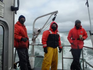 The crew bundles up against the arctic winds blowing on deck. Credit: NOAA.