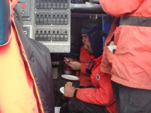 The crew takes a quick break to eat between sampling. Credit: NOAA.