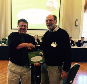 Dr. Michael Dowgiallo (left) receives a plaque during the U.S. Coral Reef Task Force Meeting on February 18, 2016 from Dr. Richard Appeldoorn (right) picturing Atergopedia dowgialli n. sp., the new Caribbean mesophotic copepod species named for him. Credit: David Ballantine, UPR