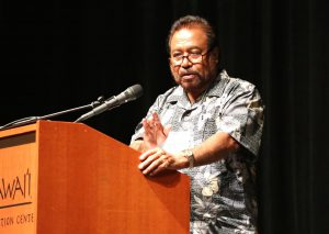 Mr. Noah Idechong, Senior Advisor to the Minister of Natural Resources, Environment, and Tourism in Palau and former Speaker of the Palau National Congress, presents the Micronesian leaders' Call to Action for coral reef protection at the 13th International Coral Reef Symposium, Honolulu, HI (credit: Kristen Weiss, Center for Ocean Solutions)