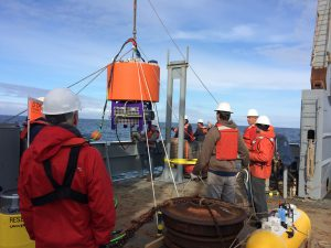 Scientists deploy the environmental sample processor (ESP) off the coast of Washington, to monitor the presence of Pseudo nitzschia and their toxin, domoic acid. Credit: NOAA.