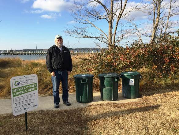 Stu Lehmann (MD Dept. of Natural Resources) stands next to the new oyster shell recycling bins at the Cooperative Oxford Laboratory in Oxford, Maryland.