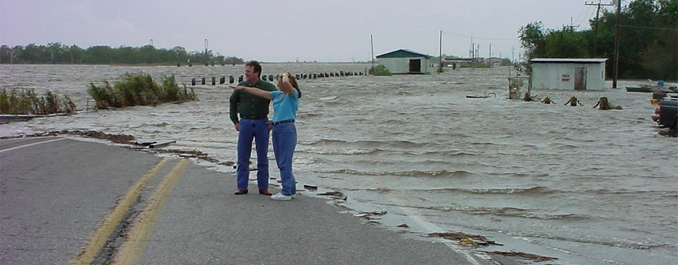 Storm surge on a Louisiana highway shows the effects of rising sea levels in the Gulf of Mexico.