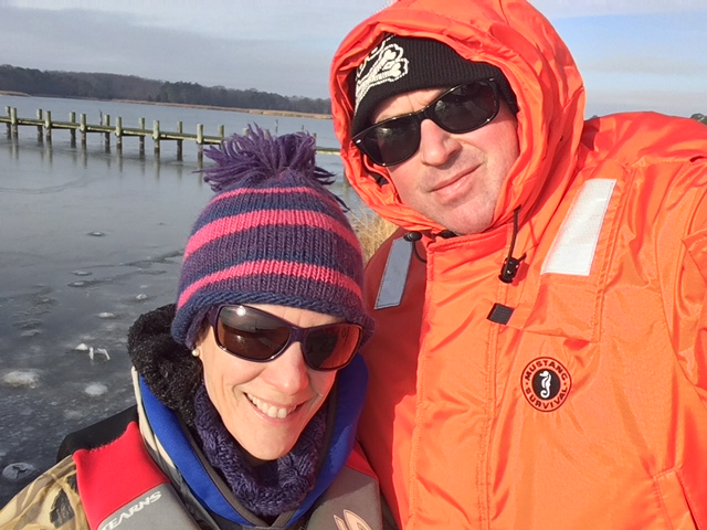 Suzanne Bricker and Matt Parker on the shore of the Chester River, a Maryland tributary of the Chesapeake Bay, await boat transport to an oyster farm.