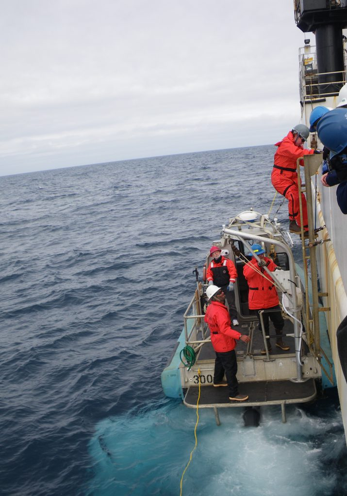 Scientists board small boat for 2015 Arctic surveys.
