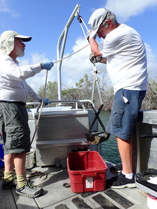 NCCOS scientists Ian Hartwell and Tony Pait retrieve PONAR sediment grab from Salt River Bay, St. Croix, USVI.