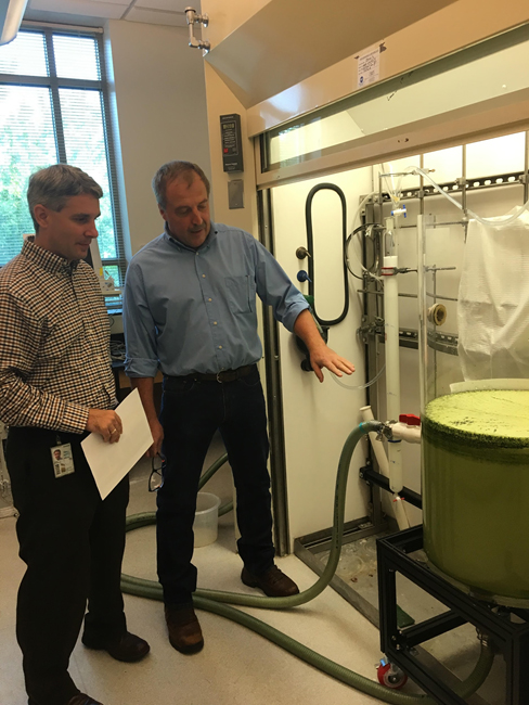 Dr. Peter Moeller demonstrates ozone nanobubble technology to Dr. Steve Thur (Director of NCCOS) at Hollings Marine Laboratory in Charleston, South Carolina.