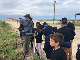 A group of children participate in a stewardship program hosted by Audubon